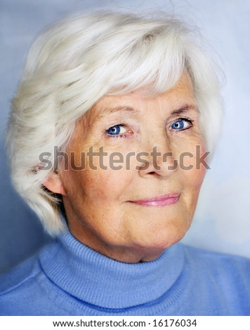 Senior lady portrait in blue pullover - stock photo