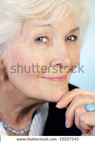 Senior lady portrait in half-profile with hand and ring - stock photo