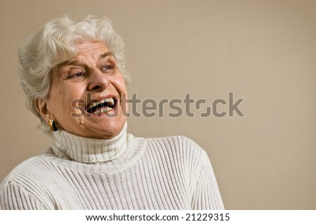 Senior lady portrait, laughing, with copy space. - stock photo
