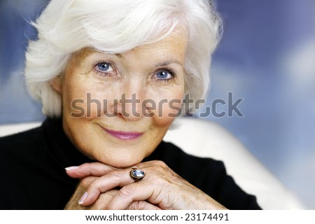 Senior lady portrait looking graciously - stock photo