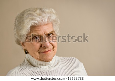 Senior lady portrait, looking to cammera,  with copy space. - stock photo
