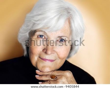Senior lady portrait on pastel yellow background - stock photo