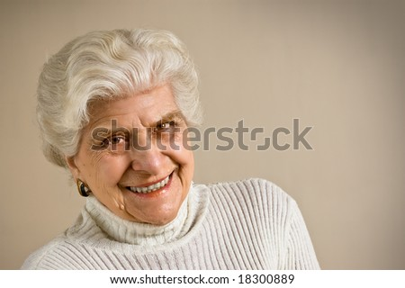 Senior lady portrait, smiling, with copy space.