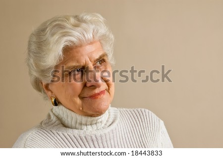 Senior lady portrait, smiling, with copy space. - stock photo