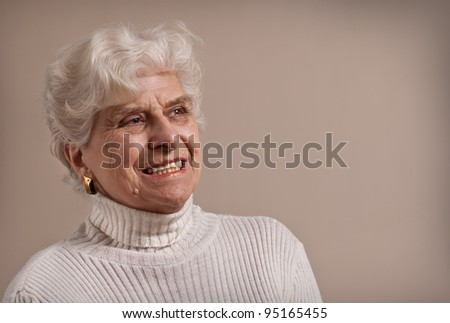 Senior lady portrait, smiling with copy space. - stock photo