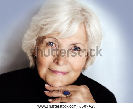 Senior lady  portrait with polo neck sweater - stock photo