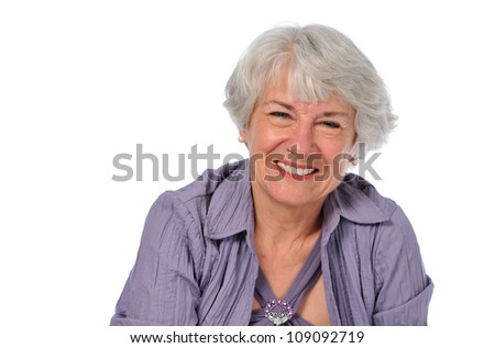 Senior Lady smiling isolated on a white background - stock photo