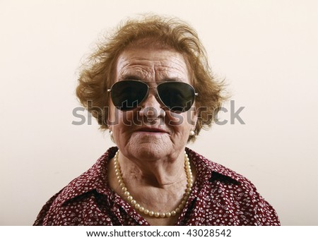 Senior lady wearing sunglasses - stock photo