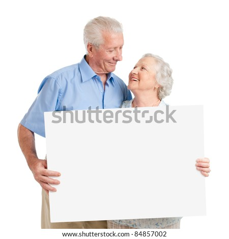 Senior lovely couple holding together a white board isolated on white background - stock photo