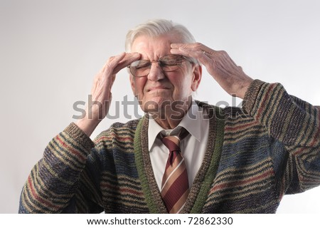 Senior ma suffering from headache
