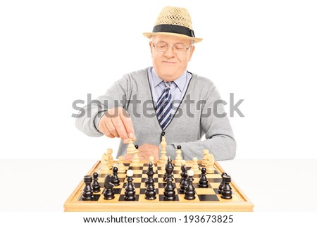 Senior making a move on a chessboard isolated on white background - stock photo
