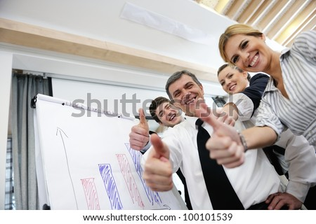 Senior male business man giving a presentation at a  meeting at modern light office on a table board - stock photo