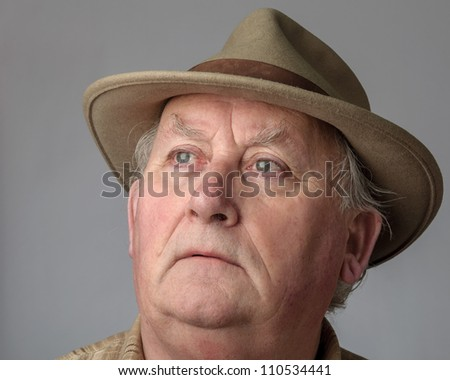 senior male close up portrait in hat - stock photo