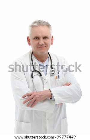 Senior male doctor or physician standing in a white labcoat with a stethoscope around his neck and his arms crossed on a white background
