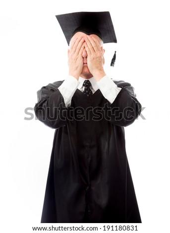 Senior male graduate hiding his face - stock photo