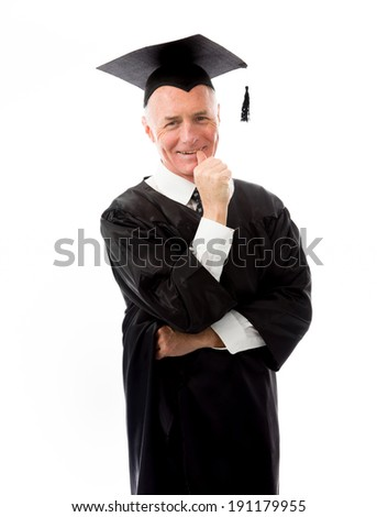 Senior male graduate standing with finger in mouth