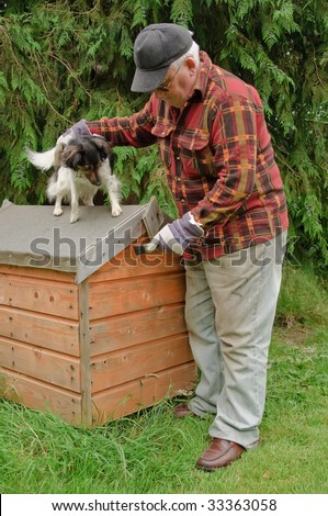 senior male preparing dog house for painting