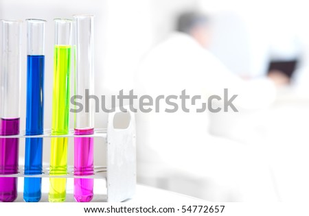 senior male researcher carrying out scientific research in a lab (color toned image) - stock photo
