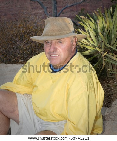 Senior male sitting outdoor in nature