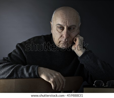 Senior man absorbed in thought - stock photo