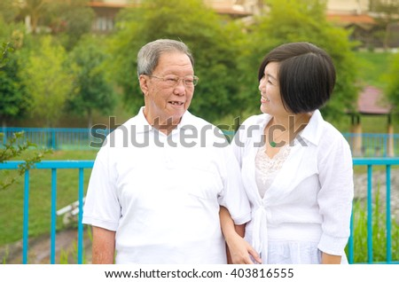 Senior man and daughter. Happy father talking with her daughter. - stock photo