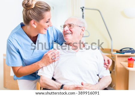 Senior man and old age nurse in nursing home - stock photo