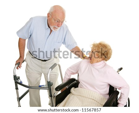 Senior man and woman in a nursing home exchanging gossip.  Isolated on white. - stock photo