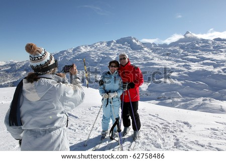 Senior man and women being photographed in snow