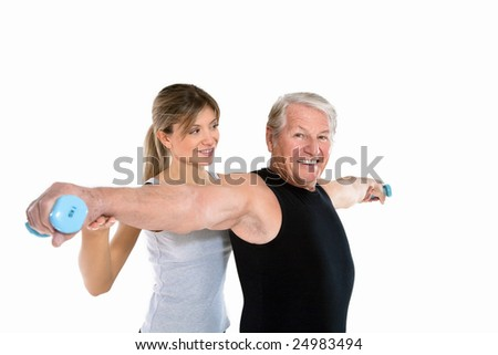 senior man and young woman exercising in gym. Copy space - stock photo