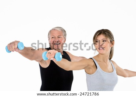 senior man and young woman exercising in gym. White background - stock photo