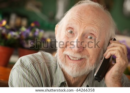 Senior man at home on the telephone