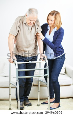 Senior man at physiotherapy at home with a physiotherapist - stock photo