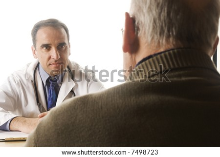 Senior man at the doctor's office - stock photo