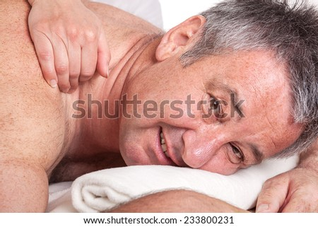 Senior man at the massage - stock photo
