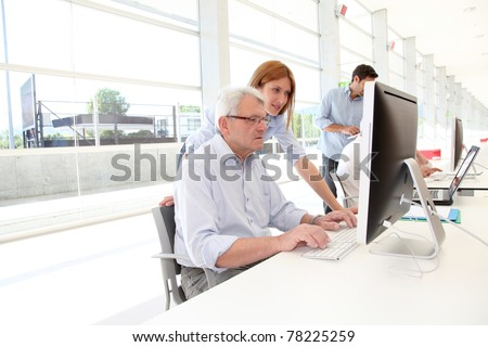 Senior man attending business training - stock photo