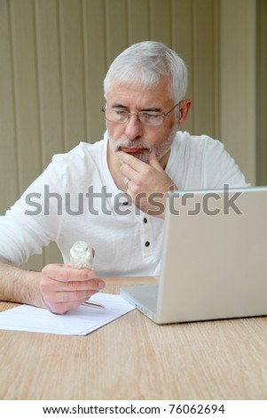 Senior man checking medical information on internet