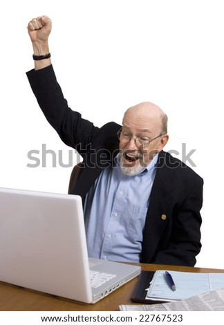 Senior man cheering with happiness at something he's just read on his laptop. - stock photo