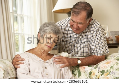 Senior Man Comforting Unhappy Wife At Home - stock photo