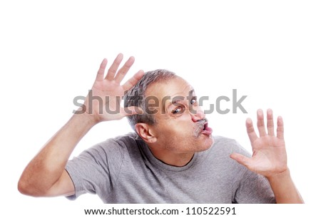 Senior man crushed on transparent glass - stock photo