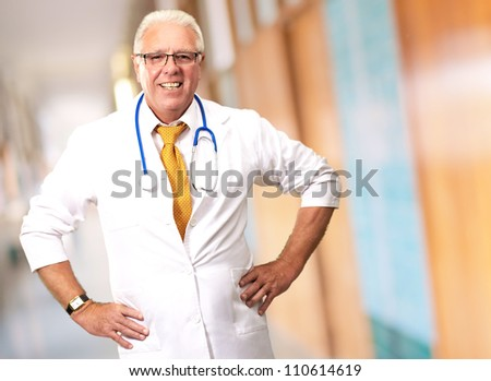 Senior Man Doctor With Hand On Hip, Indoor - stock photo