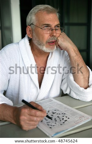 Senior man doing crosswords