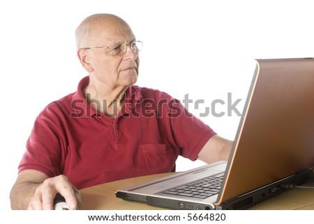 senior man doing research on-line. - stock photo