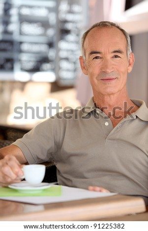 Senior man drinking a cup of espresso - stock photo