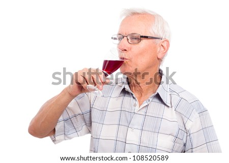Senior man drinking glass of red wine, isolated on white background. - stock photo