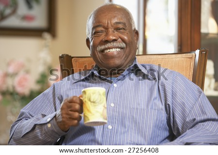 Senior man drinking hot beverage