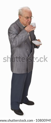 Senior man drinking tea (or coffee) from a cup. - stock photo