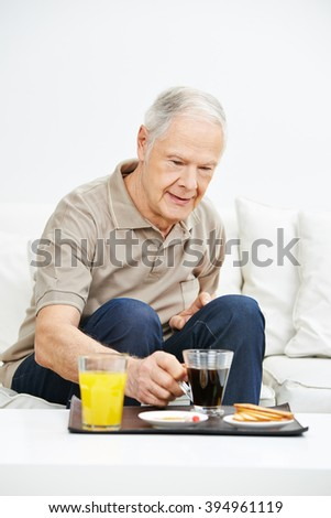 Senior man eating a healthy breakfast in a nursing home