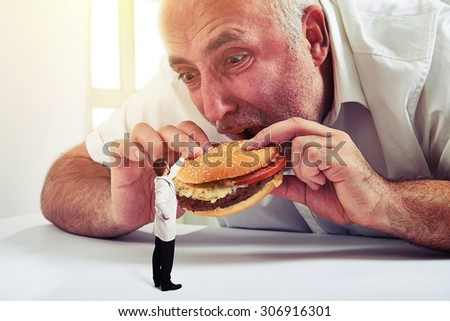 senior man eating burger and small doctor looking at him and protesting against junk food