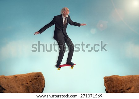 senior man enjoying the risk of a jumping challenge on skateboard