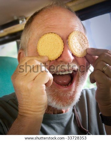 Senior man enjoys a moment with cookies and humor